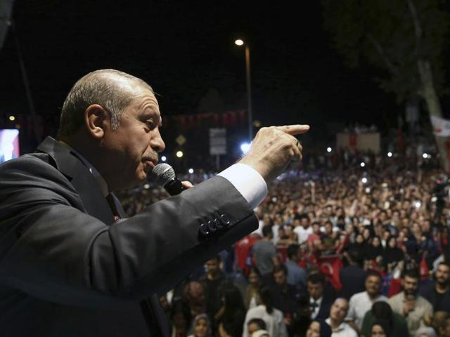 Turkey's President Recep Tayyip Erdogan addresses his supporters gathered in front of his residence in Istanbul on early Tuesday.
