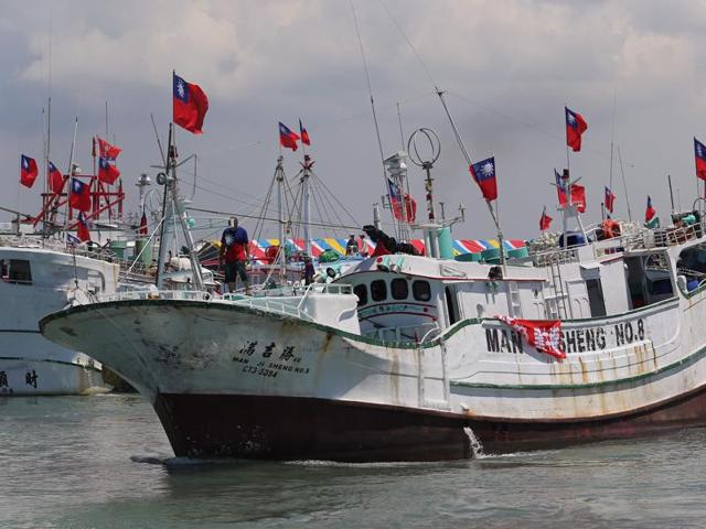 Taiwanese fishing boats are seen departing to Taiping island, part of the disputed Spratly Islands chain in the South China Sea, at a fishing harbour in southern Pingtung.