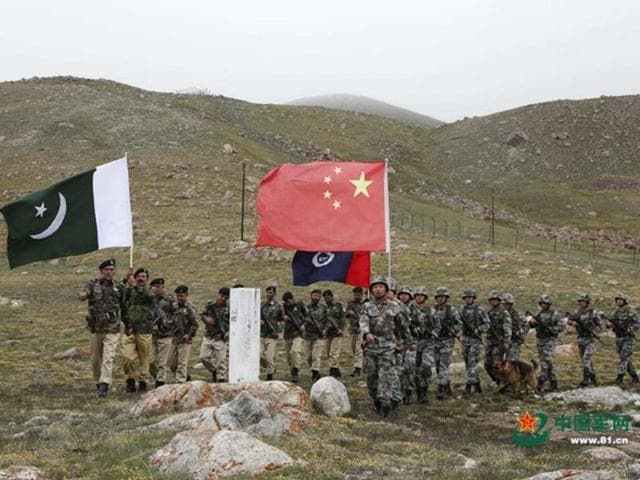 Chinese and Pakistan troops jointly patrolling the border connecting PoK with Xinjiang region.