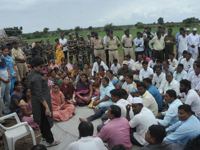 Pune police commissioner Rashmi Shukla talks to the villagers in Kopardi.