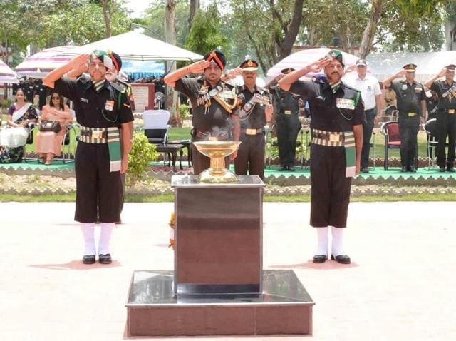 Lieutenant General KJ Singh (centre), general officer commanding-in-chief of the Western Command, paying tributes to martyrs during the inauguration of a war memorial at Cheema village, close to the border, in Tarn Taran district on Wednesday.