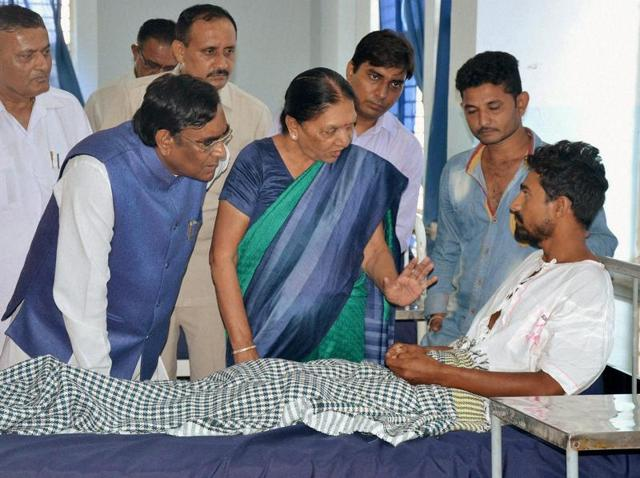 Gujarat chief minister Anandiben Patel on Wednesday visits one of the Dalit youth who was assaulted by 'cow vigilantes' in Rajkot.