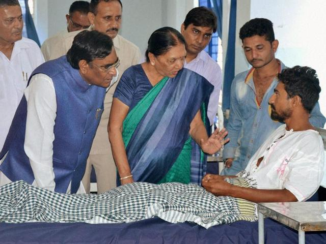 Gujarat chief minister Anandiben Patel visits a man who was assaulted by members of a self-styled cow protection group recently.