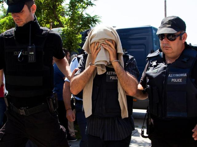 One of the eight Turkish soldiers who fled to Greece in a helicopter and requested political asylum after a failed military coup against the government, is escorted to the courthouse of the northern city of Alexandroupolis in Greece.