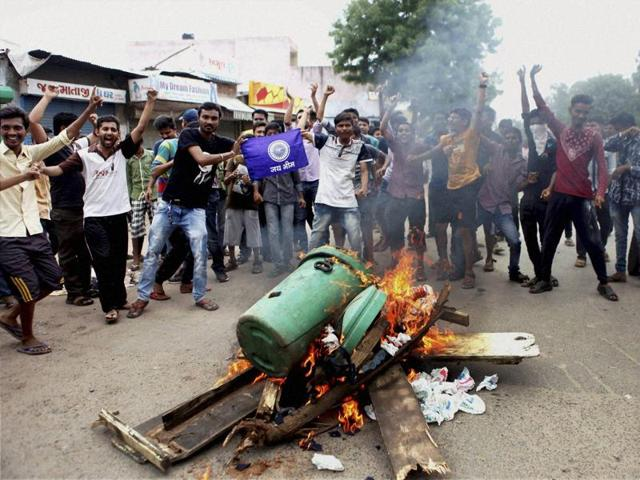 Members of Dalit community block traffic during a protest in Ahmedabad.