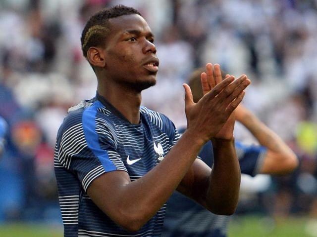 France's midfielder Paul Pogba celebrates after winning the Euro 2016 semi-final football match.