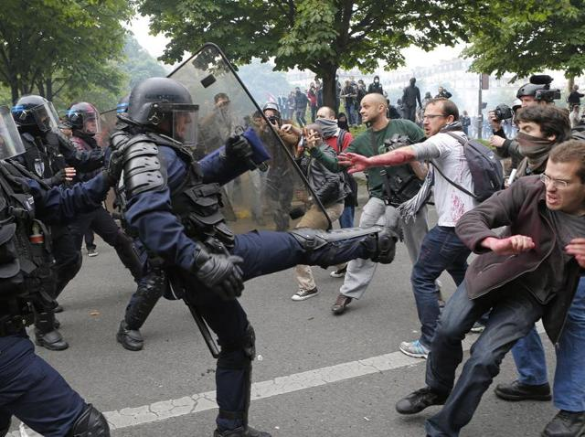 This May 26, 2016 file photo shows riot police officers clashing with protestors during a demonstration held in Paris, France.