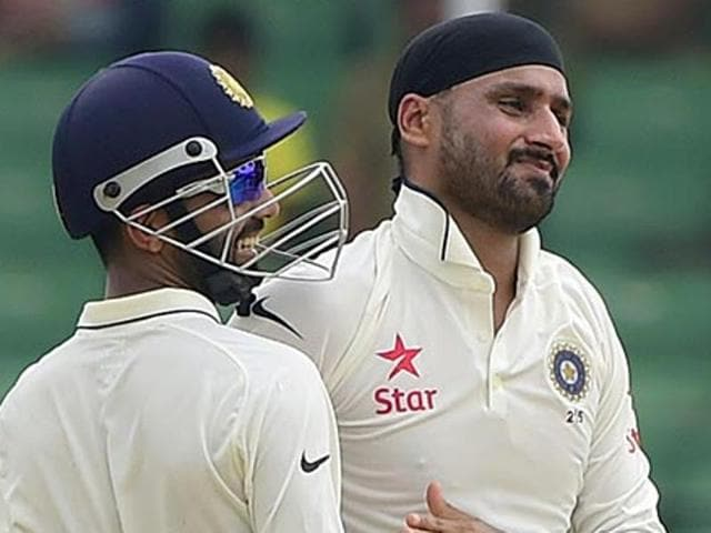 A file photo of Harbhajan Singh celebrating with teammate Ajinkya Rahane.
