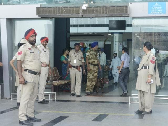Central Industrial Security Force (CISF) personnel at Sri Guru Ram Dass Jee International Airport on Thursday.