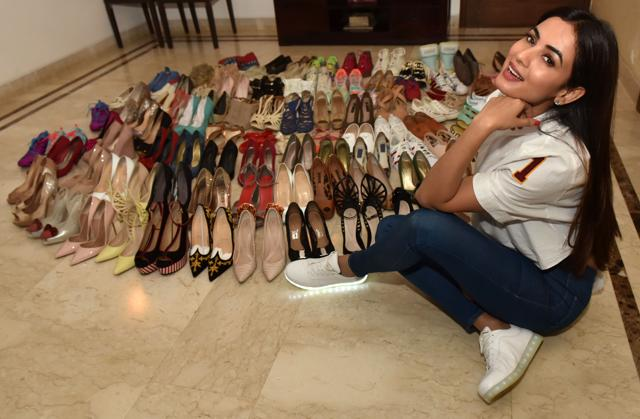 Actor Sonal Chauhan with her collection of heels