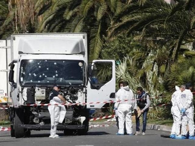 Investigators at the scene near the heavy truck that ran into a crowd at high speed killing scores who were celebrating the Bastille Day July 14 national holiday on the Promenade des Anglais in Nice, France, July 15, 2016.
