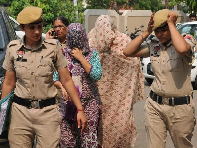 The accused in the child-trafficking case being taken to a court in Jalandhar on Wednesday.