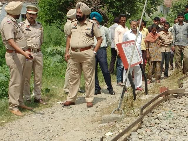 Police personnel investigating the spot from where the bodies were recovered on Wednesday.
