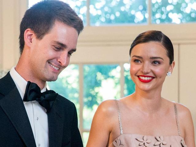 In this file photo, Miranda Kerr and her boyfriend, Snapchat CEO Evan Spiegel, arrive for a state dinner for Nordic leaders at the White House in Washington.