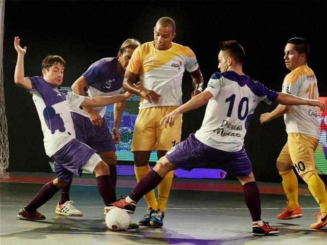Players of Chennai 5s and Kochi 5s (Purple) in action during their match of Premier Futsal.