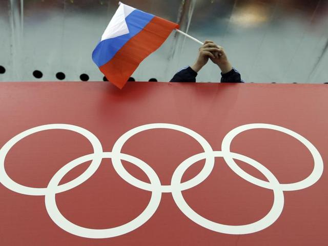 A file photo showing the shadow of a man on the Olympic rings at the Rosa Khutor Alpine Center.