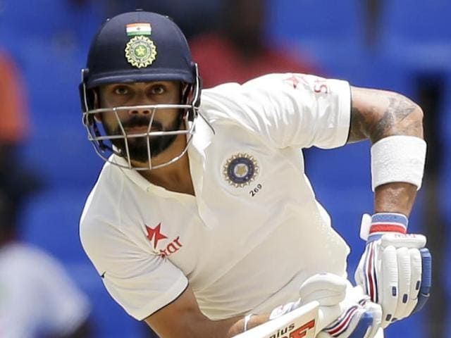 India's Shikhar Dhawan plays a shot bowled by West Indies' captain Jason Holder.
