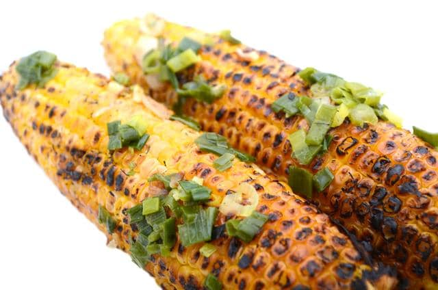 A man grills corn at one of the many bhutta stalls that pop up across the city once the rains set in.