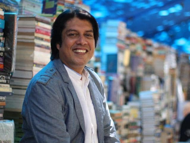 A man reads a book at a roadside bookstall in Fort, Mumbai.