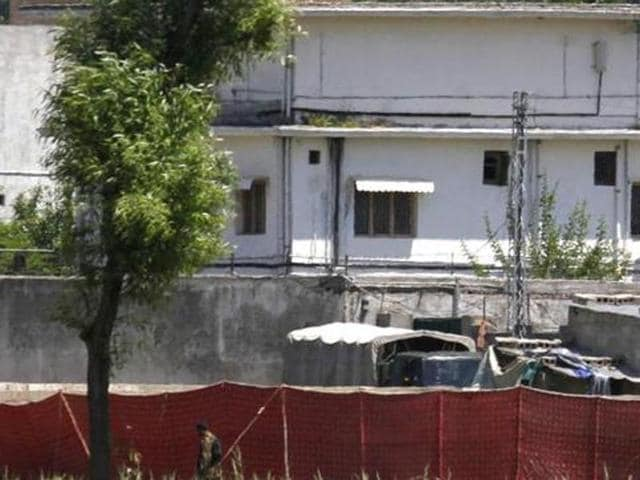 In this file photo, Pakistani soldier stands near a compound in Abbottabad where al Qaeda leader Osama bin Laden was killed by US Navy Seals.