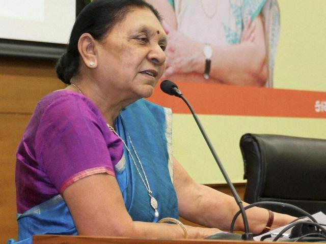 Gujarat chief minister Anandiben Patel visits a Dalit victim who was assaulted by a cow-vigilante group, at a hospital in Rajkot district.