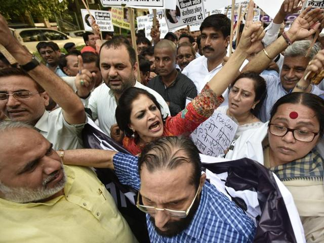BJP workers shout slogans against Delhi Chief Minister Arvind Kejriwal demanding justice to the AAP activist who  committed suicide on Tuesday. Another party worker has filed a case of molestation and threat against three men.
