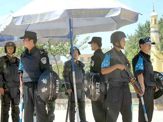 In this file photo, Chinese police officers stand guard near the site of an attack in Kashgar in China's far-western Xinjiang Uygur Autonomous Region.