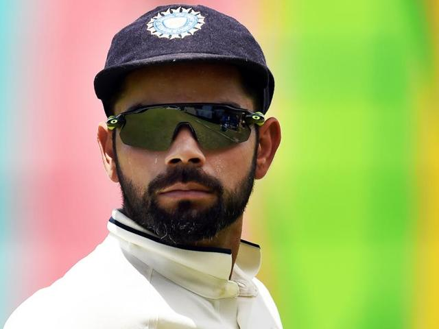 India's captain Virat Kohli celebrates his century on Day One of the first Test against West Indies at the Sir Vivian Richards Stadium in North Sound, Antigua, on Thursday.