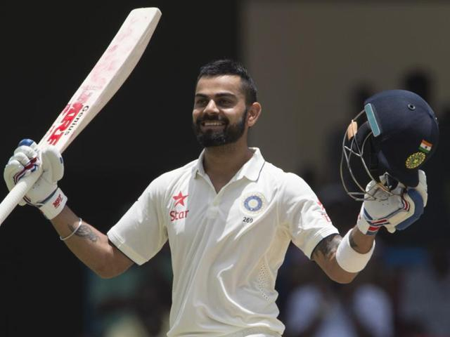 India's captain Virat Kohli celebrates after scoring a double century during day two of the first Test match.