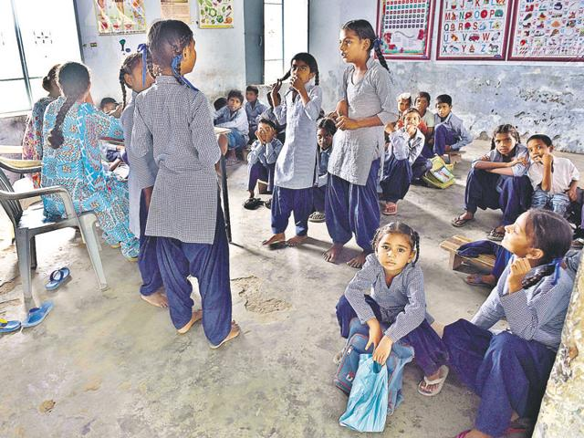 Students of Government Elementary School at Chakbala village in Amritsar district sitting on the floor due to lack of furniture.