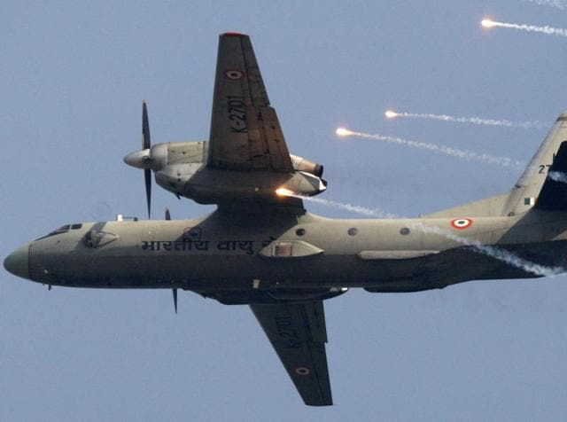 In this file photo, Indian Air Force's (IAF) AN-32 transport aircraft releases chaff as it flies past the IAF Day Parade in New Delhi.