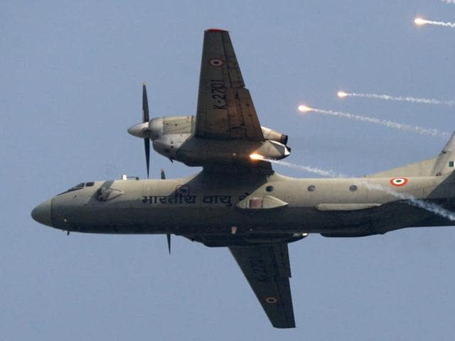 In this 2009 file photo, an IAF AN-32 transport aircraft releases chaff as it flies past the IAF Day Parade in New Delhi.