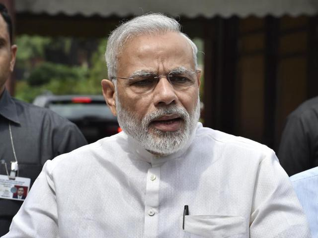 Narendra Modi talks to the media after his arrival at the opening day of the monsoon session of the Parliament, in New Delhi.