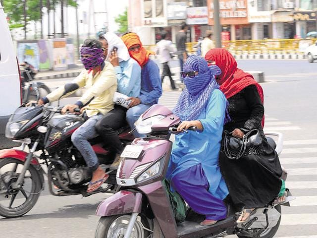 Girls usually cover their faces with scarves to shield themselves from the sun and pollution.