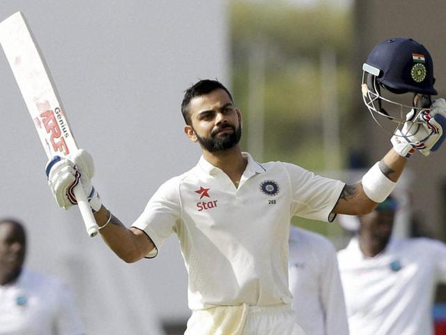 India's captain Virat Kohli plays a shot from the bowling of West Indies' captain Jason Holder.