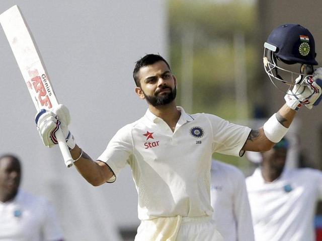 India's captain Virat Kohli celebrates after he scored his double century.