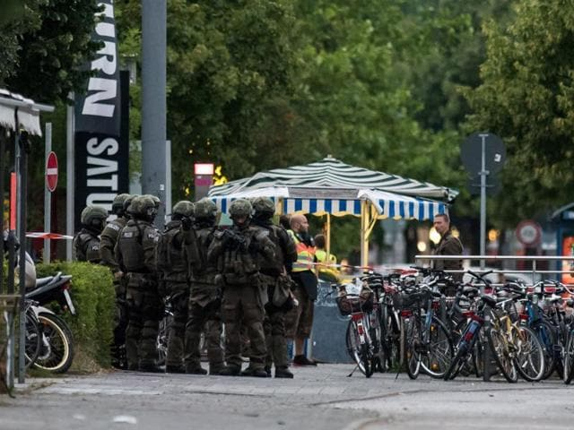 Police secure an area in Munich following a shooting earlier at a shopping mall.