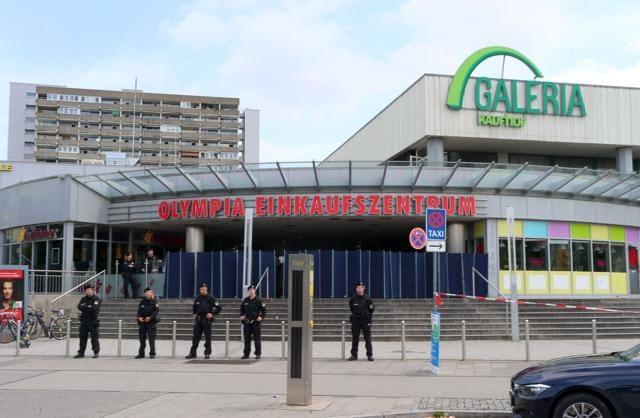 Police officers secure the area around a McDonald restaurant near the shopping mall Olympia Einkaufzentrum OEZ in Munich on July 23,  a day after a gunman went on a shooting rampage, killing nine people.