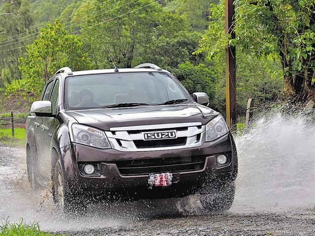 The Isuzu D-Max V-Cross' muscular and chrome-heavy front grille, flanked by large projector headlights, gives it an imposing road presence.