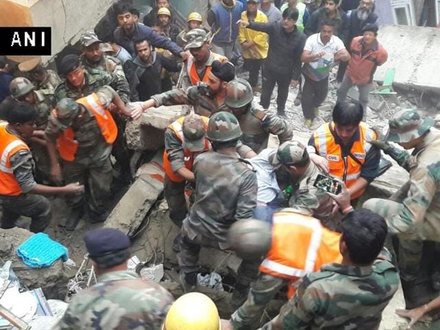 The four-storeyed building collapsed at about 10.30 pm on Friday night, a police official said.