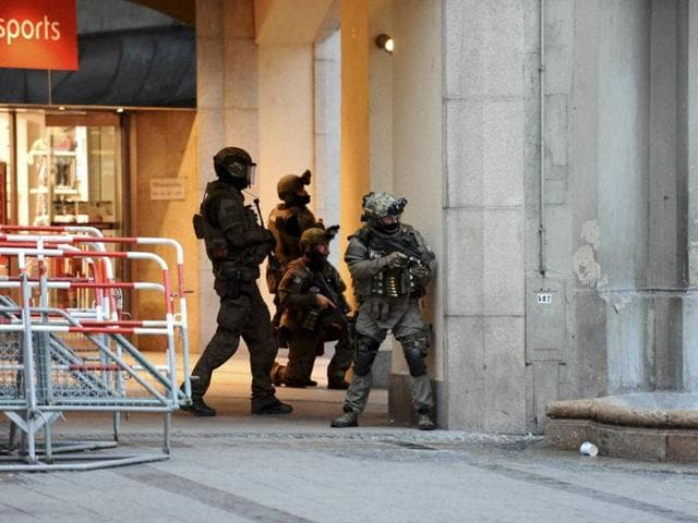 Police forces operate at Karlsplatz (Stachus) square after the attack on Friday. Nine persons were killed and 21 injured when a gunman went on a shooting rampage in a mall in Munich in Germany.