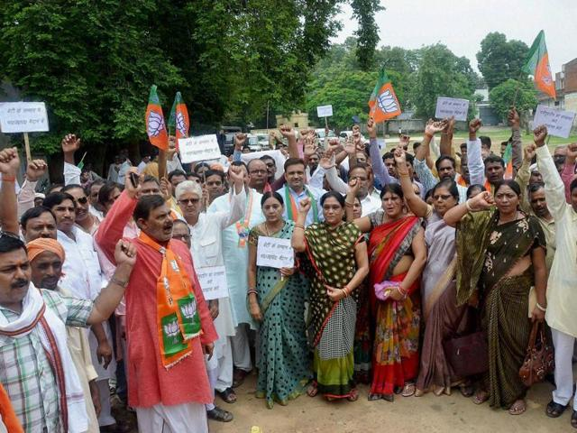 BJP workers protest against BSP general secretary Nasimuddin Siddqui over his comments on Dayashankar's family members, in Mirzapur on Saturday.