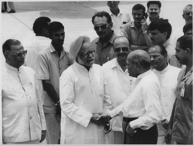 Prime Minister PV Narasimha Rao with then finance  minister Manmohan Singh, and other cabinet colleagues and senior officials at the Delhi airport,  before leaving for a visit to Russia in June 1994