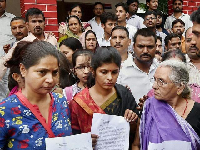 Expelled BJP leader Daya Shankar Singh's mother (R), wife Swati Singh (C) and others after filing a complaint against Mayawati and other BSP leaders at a police station, in Lucknow on Friday, July 22, 2016.  The BJP will protest  the 'foul' language used against Singh's family by BSP.