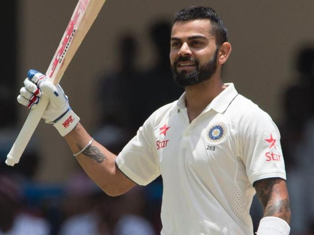 India cricketer Virat Kohli celebrates after batting 200 runs against West Indies.