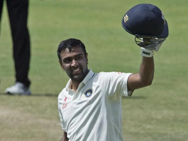 India's Ravichandran Ashwin raises his bat after scoring a century, his first overseas and third overall in Test cricket, at the Sir Vivian Richards Stadium in North Sound, Antigua, on Friday.