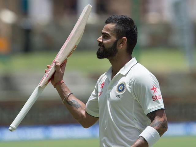 India's captain Virat Kohli celebrates after scoring a double century against West Indies.