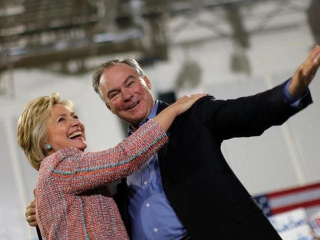 Democratic US presidential candidate Hillary Clinton and US senator Tim Kaine react during a campaign rally at Ernst Community Cultural Center in Annandale.