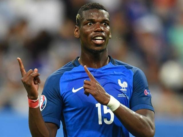 France's midfielder Paul Pogba applauds prior to the Euro 2016 semi-final football match.
