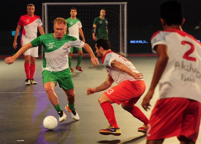 Bengaluru 5's Paul Scholes (C) plays against Goa 5's during their Premier Futsal Football League match.